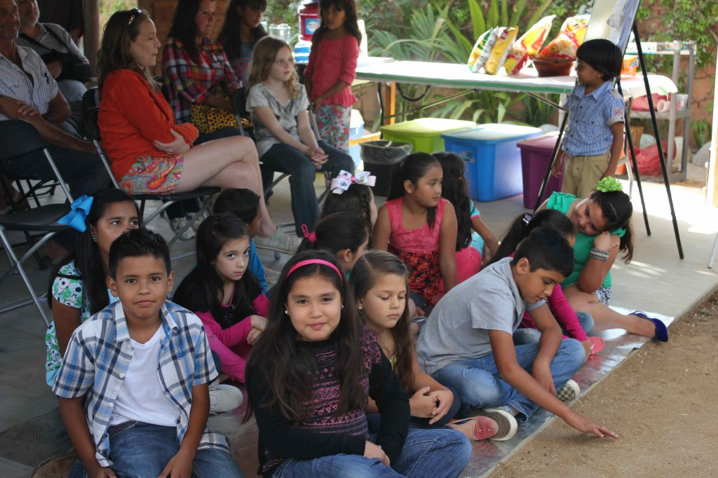 The youngest kids gathering and waiting for their turn to shine.