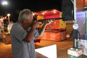 Burt tries his hand with the BB gun.