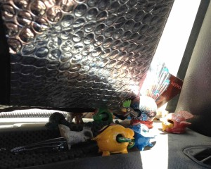 My dashboard menagerie. They keep me and the dogs company while Burt runs errands.