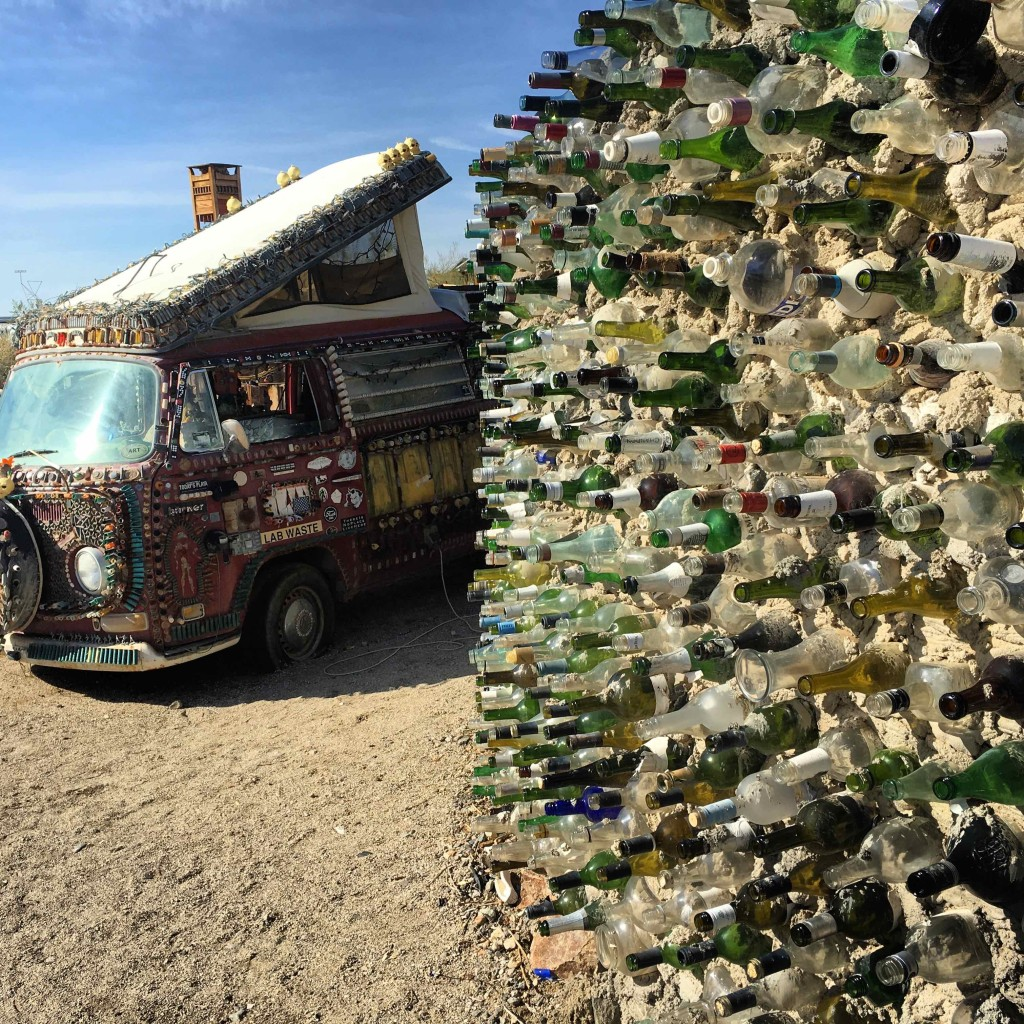 Bottle wall and the munitions covered VW van.