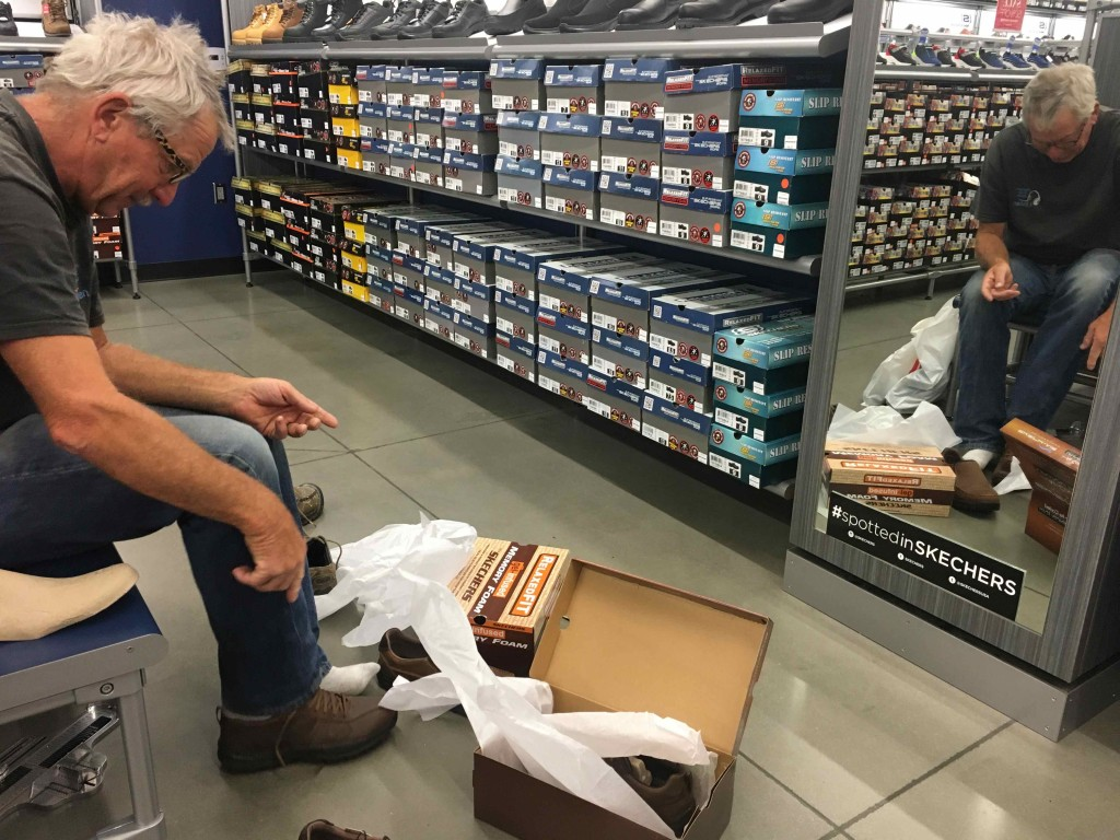 Nine toed man shops for shoes.