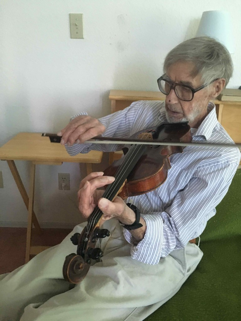 Bob on Bob's fiddle. Originally his father's fiddle.