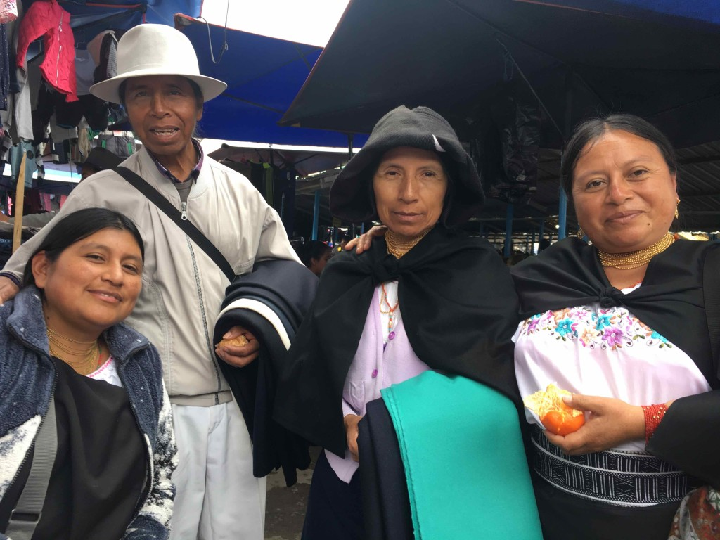 Merchants at Otavalo market. Elsi (left) and aunts and uncle.