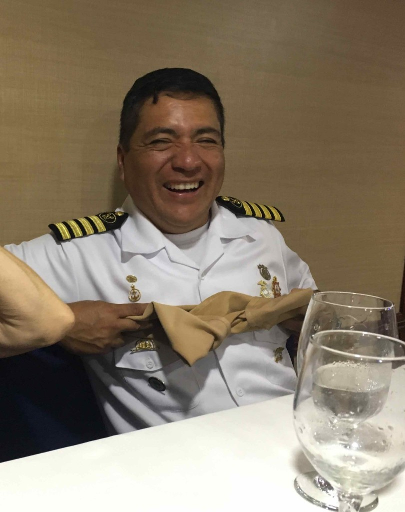 The captain demonstrates how to make origami boobies.