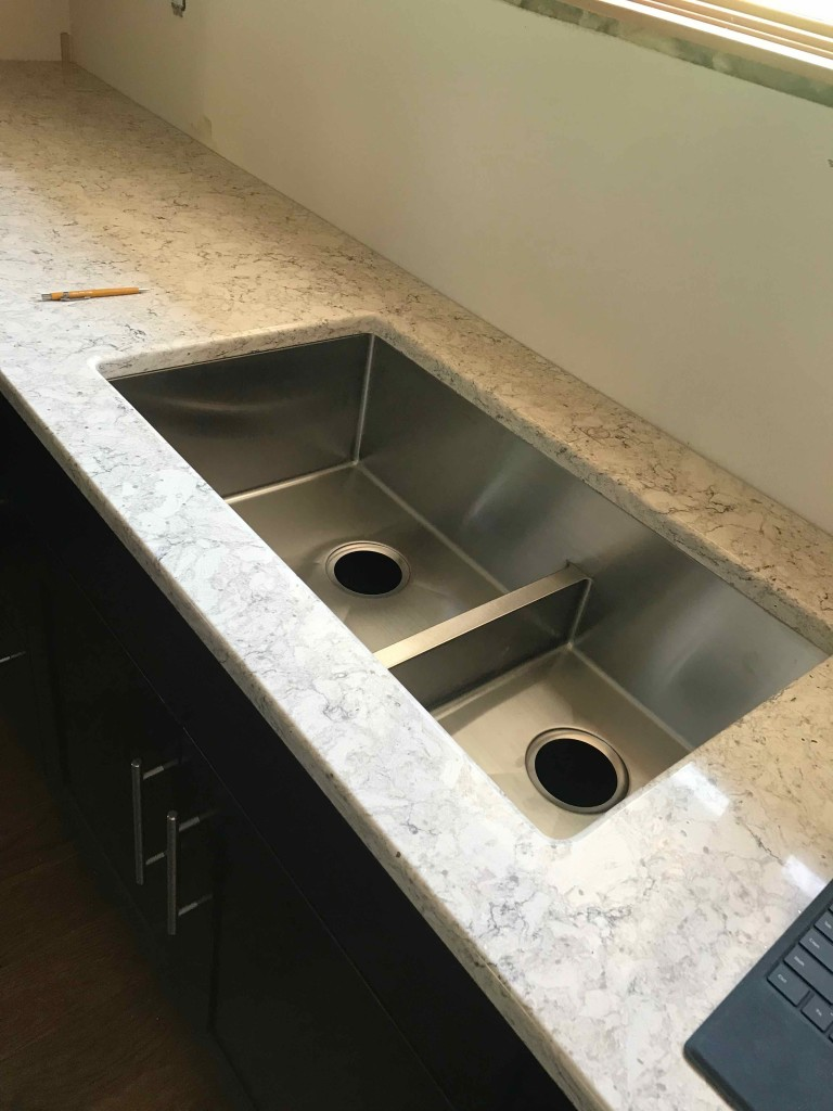 Undermount sink with half divider.