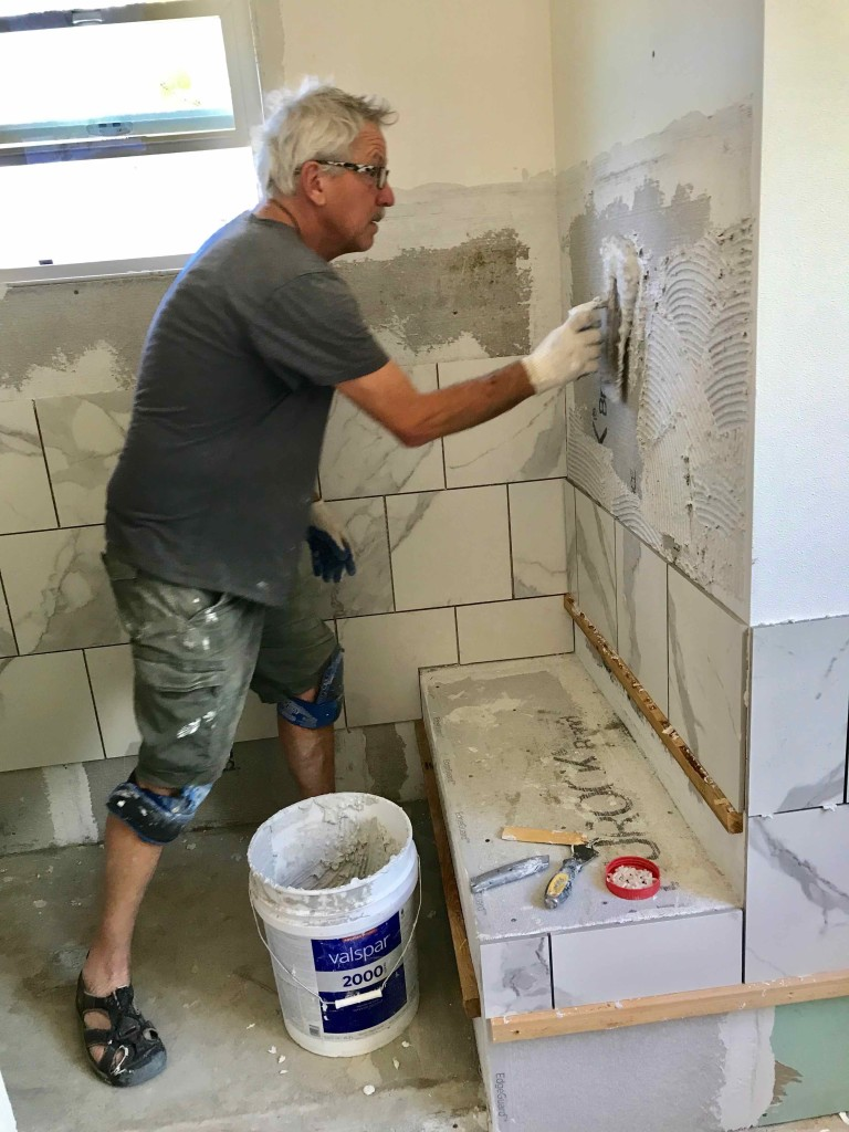 Installing a marble style tile.