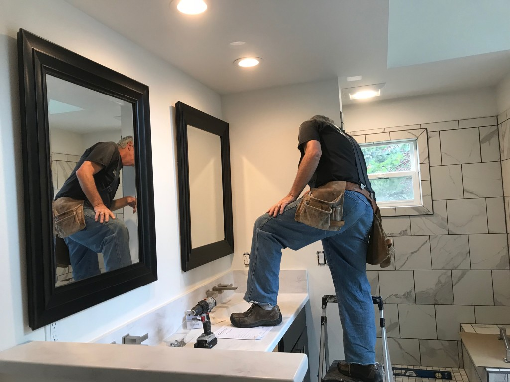 Double vanity with carpenter.