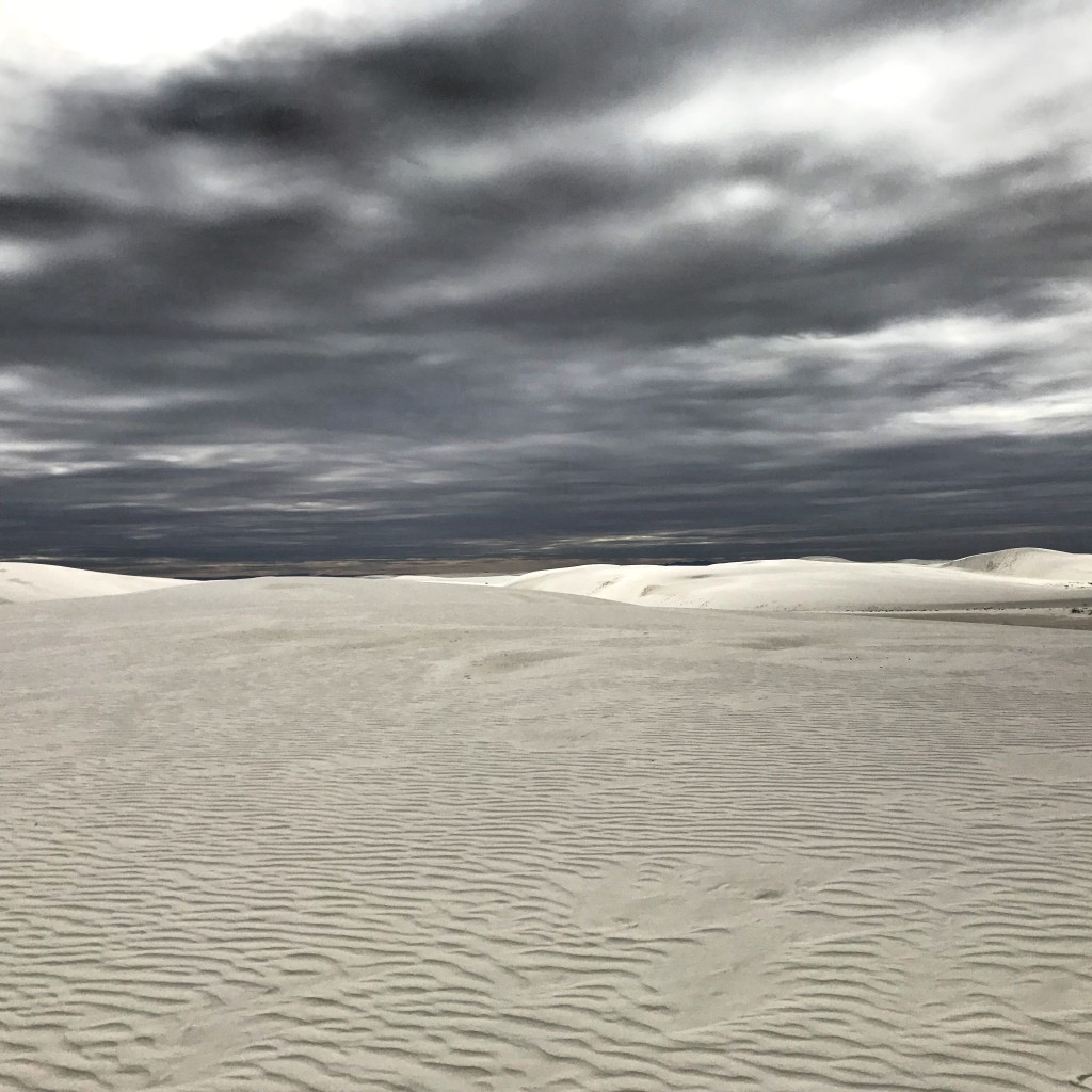 The play of light in White Sand Dunes National Monument resembles the ocean.